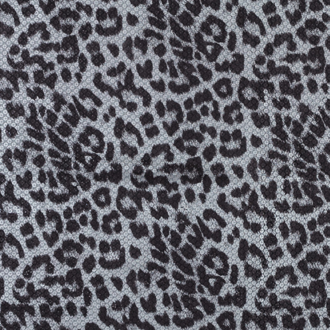 circle sequins with a snow leopard top foil and a black knit backing 318381 11